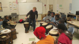 Youth drumming with Randy Armstrong